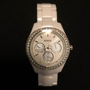 White and silver woman's fossil watch